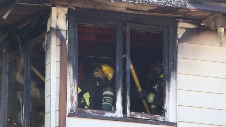 Firefighters in Surrey are seen putting out a blaze inside a home on 112a Avenue on Aug. 28, 2020.