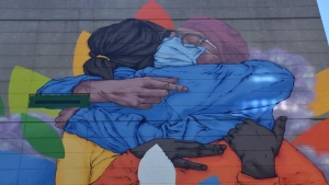 Patrick Forchild's mural is a six-storey homage to health-care workers overflowing with colour and emotion.