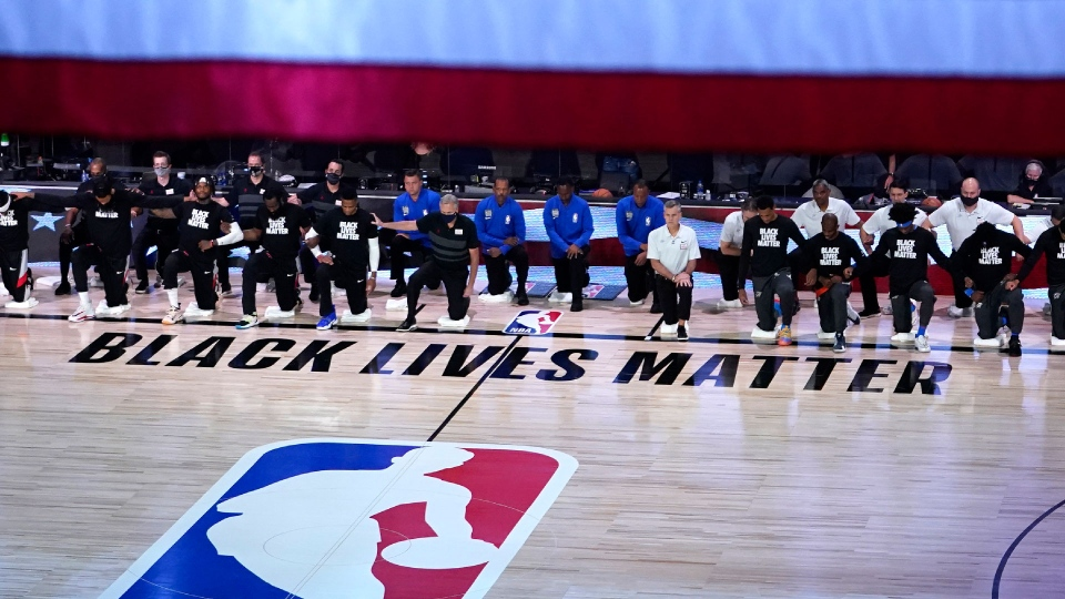 The Houston Rockets and Oklahoma City Thunder kneel during the national anthem before an NBA basketball first round playoff game Saturday, Aug. 29, 2020, in Lake Buena Vista, Fla. (AP / Ashley Landis)