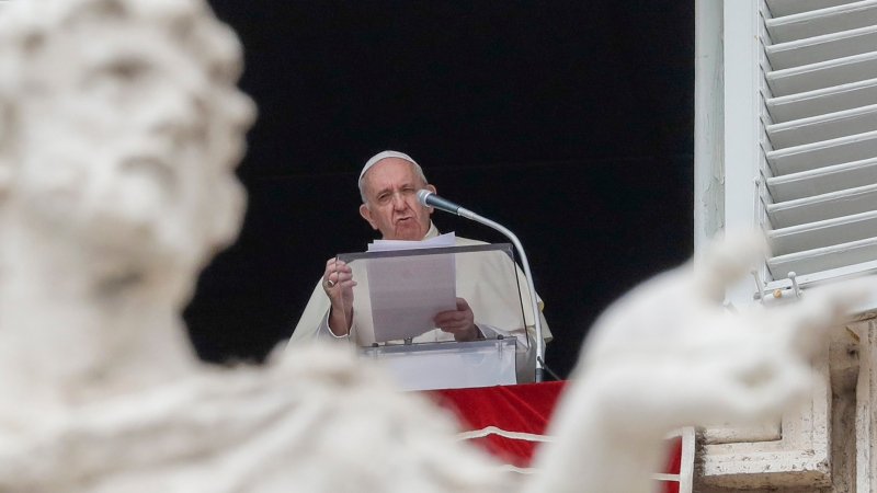 FILE - Pope Francis delivers his speech as he recites the Angelus noon prayer from the window of his studio overlooking St.Peter's Square, at the Vatican, Sunday, Aug. 30, 2020. (AP Photo/Andrew Medichini)