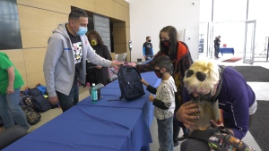 "Can Man Dan giving away backpacks full of school supplies at the 8th annual ""We're Here For Ya Day."" Sunday Aug. 30, 2020 (Jay Rosove/CTV News Edmonton)"