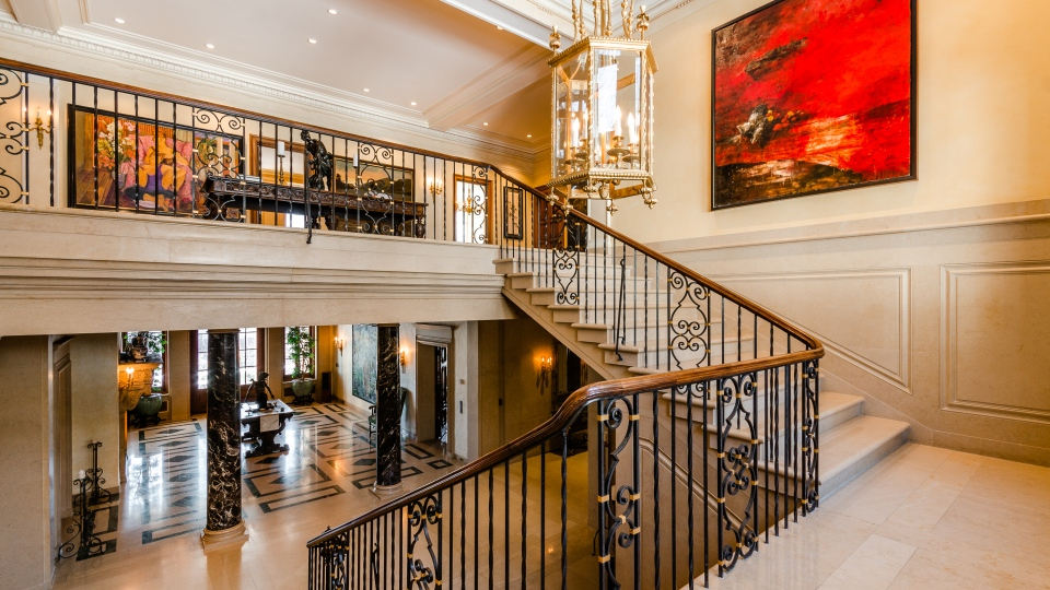 Marble staircase leads to the second floor