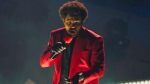 """In this video grab issued Sunday, Aug. 30, 2020, by MTV, The Weeknd performs """"Blinding Lights"""" during the MTV Video Music Awards. (MTV via AP)"""