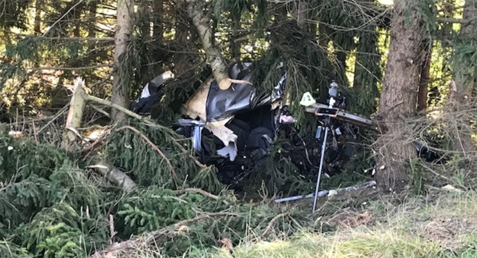 A vehicle rests among the trees after what police call a 'catastrophic' fatal crash north of London, Ont. on Monday, Aug. 31, 2020. (Sean Irvine / CTV News)