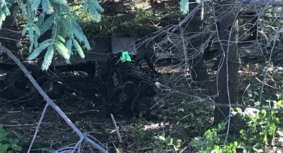 An engine that separated from the vehicle is seen after a fatal crash north of London, Ont. on Monday, Aug. 31, 2020. (Sean Irvine / CTV News)