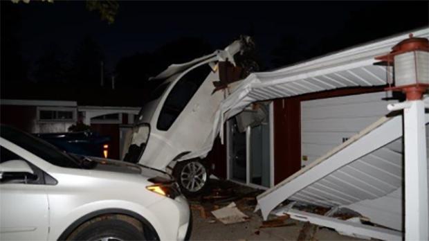Car hits house in Sarnia