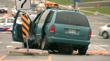 The minivan involved in the crash sits damaged on Kennedy Road, Tuesday, Oct. 13, 2009.