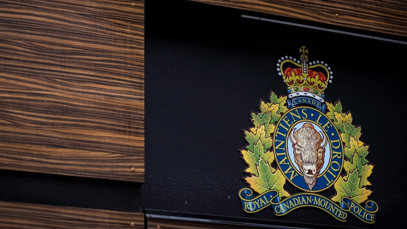 "The RCMP logo is seen outside Royal Canadian Mounted Police ""E"" Division Headquarters, in Surrey, B.C., on Friday April 13, 2018. A lawyer representing eight news media outlets is challenging decisions made by a Nova Scotia provincial court judge regarding the redaction of RCMP search warrants used in the investigation of the mass shooting in April that claimed 22 lives. THE CANADIAN PRESS/Darryl Dyck"