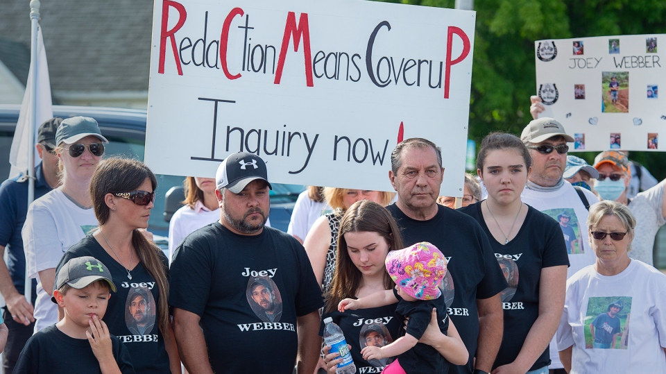 Family and friends of victim Joey Webber attend a march demanding an inquiry into the April mass shooting in Nova Scotia that killed 22 people, in Bible Hill, N.S. on Wednesday, July 22, 2020. A lawyer representing eight media outlets submitted an application Monday for a judicial review of decisions that redacted search warrants before being released to the public. (THE CANADIAN PRESS/Andrew Vaughan)