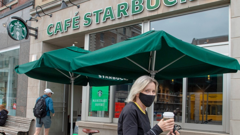 A customer leaves a Starbucks cafe in Montreal on June 10, 2020. (THE CANADIAN PRESS/Ryan Remiorz)