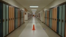 Pylons divide a school hallway in Calgary as directional arrows aim to direct foot traffic as school resumes during the COVID-19 pandemic