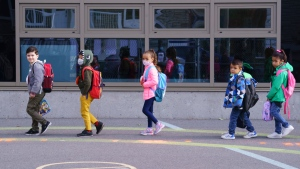Students try to keep their distance as they enter the Philippe-Labarre Elementary School in Montreal, on Thursday, August 27, 2020. Thousands of Quebec students return to class in the shadow of the COVID-19 pandemic. THE CANADIAN PRESS/Paul Chiasson