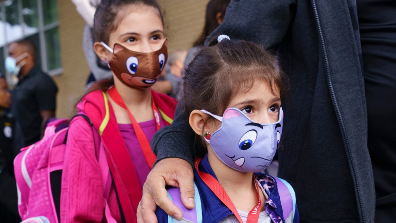 Students line up to enter the Philippe-Labarre Elementary School in Montreal, on Thursday, August 27, 2020. Thousands of Quebec students return to class in the shadow of the COVID-19 pandemic. THE CANADIAN PRESS/Paul Chiasson