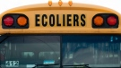 A Quebec school bus sits in a parking lot Monday August 10, 2020 in Gatineau, Que. THE CANADIAN PRESS/Adrian Wyld