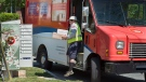 In this file photo, a Canada Post employee fills a community mail box in Dartmouth, N.S. on Thursday, June 30, 2016. THE CANADIAN PRESS/Andrew Vaughan