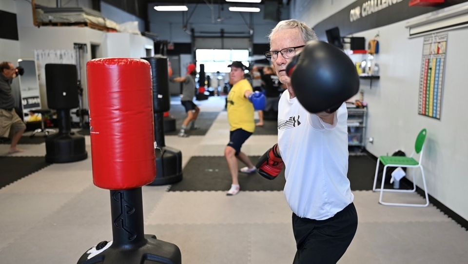 Ian Ewens takes part in a boxing class for people living with Parkinson's. (Joel Haslam/CTV)