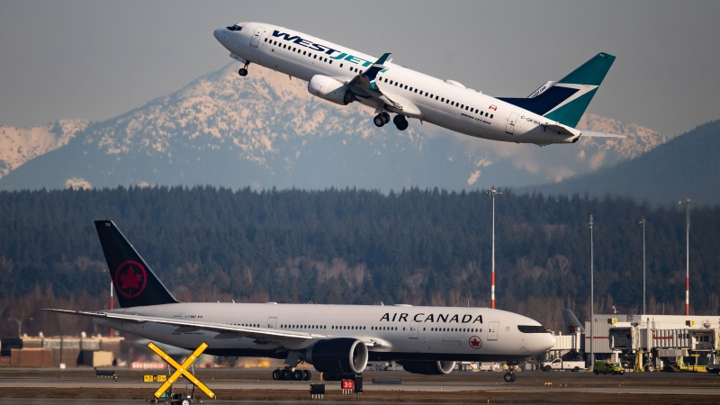 Travel packages from WestJet and Air Canada are being added to the Open For Summer Lottery in Alberta. (File photo)
