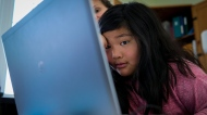 Jillian Reid, 9, uses a computer for educational purposes in Cremona, Alta., Monday, March 23, 2020, amid a worldwide COVID-19 pandemic. THE CANADIAN PRESS/Jeff McIntosh