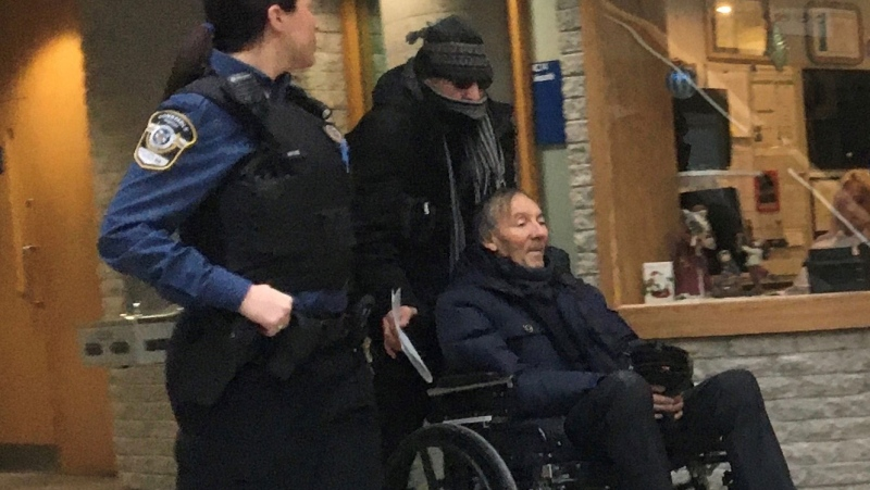 Francois Lamarre, a retired Montreal police and former minor league hockey coach in Greenfield Park, Que., appears for his arraignment at the courthouse in Longueuil, Que., Thursday, Dec.19, 2019. Longueuil police say the retired Montreal police officer arrested last December on sex-related charges has died.