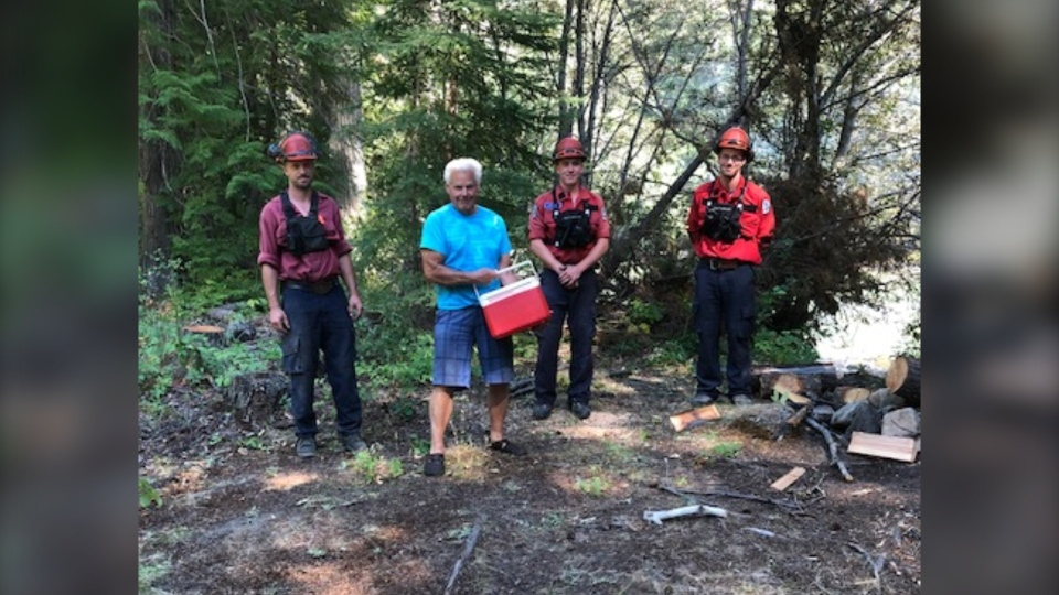 Surrey senior Dave Hall poses with BC Wildfire Service crew members and the cooler he used to help fight a wildfire between Pemberton and Lillooet last month.