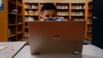 A Los Angeles Unified School District student attends an online class at Boys & Girls Club of Hollywood in Los Angeles, Wednesday, Aug. 26, 2020. (AP Photo/Jae C. Hong)