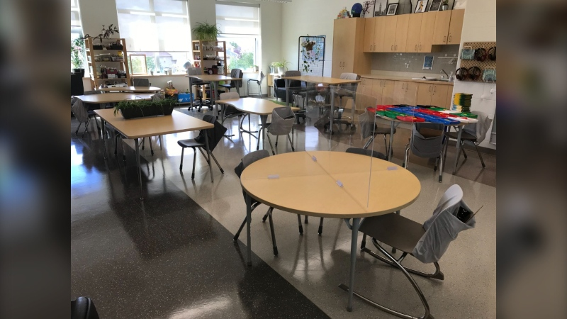 Partitions are in place on desks in a classroom at École Rivière-Rouge to give students their own space to allow them to physically distance. (CTV News Photo Josh Crabb)