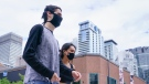Pedestrians wearing protective masks walk down Montreal's Sainte-Catherine Street, on Tuesday, September 1, 2020. The Quebec government has expressed its concern over an increasing number of COVID-19 cases in the province. THE CANADIAN PRESS/Paul Chiasson
