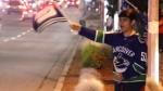 Fan celebrate as Canucks head to Game 7 against Las Vegas.