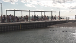 A group of people on Gord Downie Pier in Kingston, Sept. 4, 2020, the same day an emergency order mandating physical distancing in parks came into effect. (Kimberley Johnson / CTV News Ottawa)