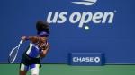 Naomi Osaka, of Japan, serves to Marta Kostyuk, of Ukraine, during the third round of the US Open tennis championships, Friday, Sept. 4, 2020, in New York. (AP Photo/Seth Wenig)