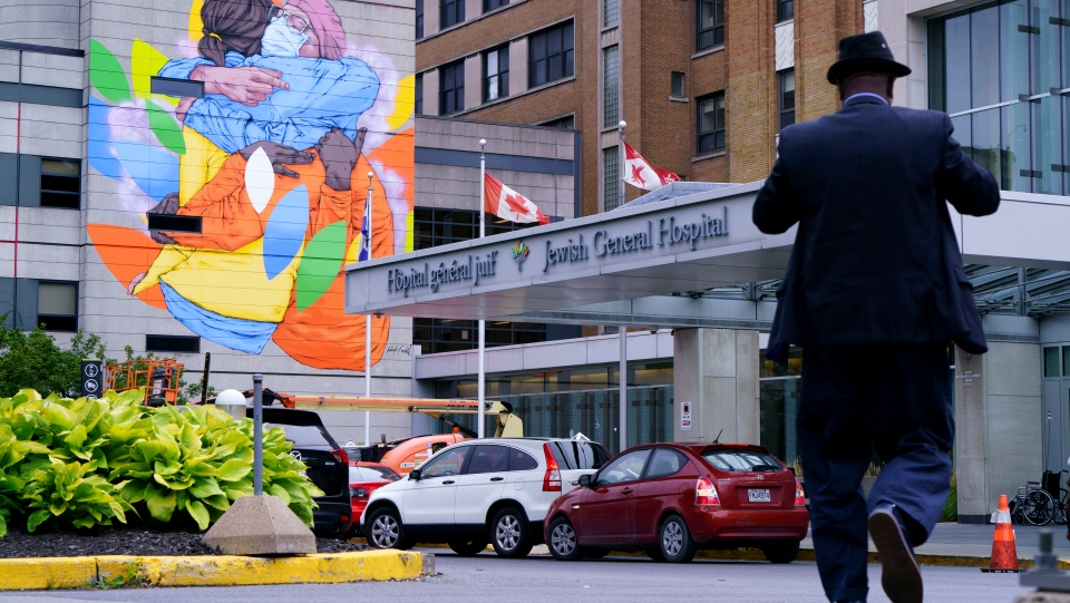 A giant mural to honour frontline healthcare workers is seen on the Jewish General Hospital in Montreal, on Tuesday, September 1, 2020. The six-story mural is by artist Patrick Forchild. THE CANADIAN PRESS/Paul Chiasson