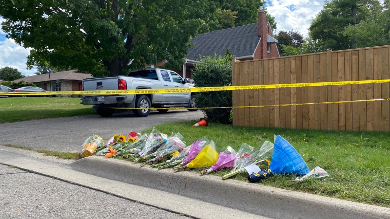 A memorial grows in front of an Oshawa, Ont. home where a father and his three children were fatally shot. (Scott Lightfoot/CTV News Toronto)
