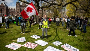 Researchers say conspiracy theories around COVID-19 are spreading at an alarming rate across the country — and they warn that misinformation shared online may lead to devastating consequences and push Canadians to shun important safety measures. Protesters gather outside the Ontario Legislature in Toronto, as they demonstrate against numerous issues relating to the COVID-19 pandemic on Saturday, May 16, 2020. THE CANADIAN PRESS/Chris Young