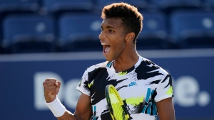 FILE PHOTO: Felix Auger-Aliassime, of Canada, celebrates after winning a match against Corentin Moutet, of France, during the third round of the US Open tennis championships, Saturday, Sept. 5, 2020, in New York. (AP Photo/Frank Franklin II)
