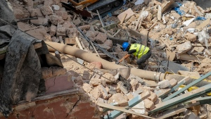 Rescuers search at the site of a collapsed building after getting signals there may be a survivor under the rubble, in Beirut, Lebanon, Saturday, Sept. 5, 2020. (AP Photo/Hassan Ammar)