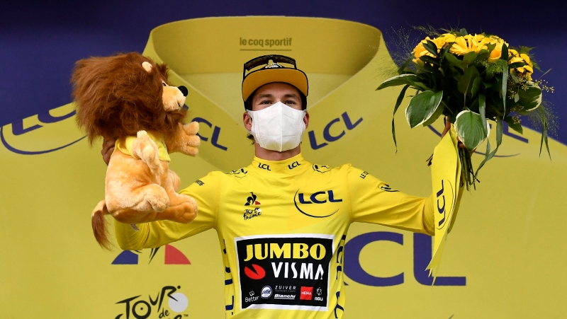 Slovenia's Primoz Roglic, wearing the yellow jersey of the overall leader, celebrates on the podium after completing the ninth stage of the Tour de France cycling race over 153 kilometers (95 miles), with start in Pau and finish in Laruns, Sunday, Sept. 6, 2020. (Marco Bertorello, Pool via AP)