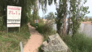A walkway along a private beach in Port Franks shows signage about the area. (Brent Lale / CTV London)