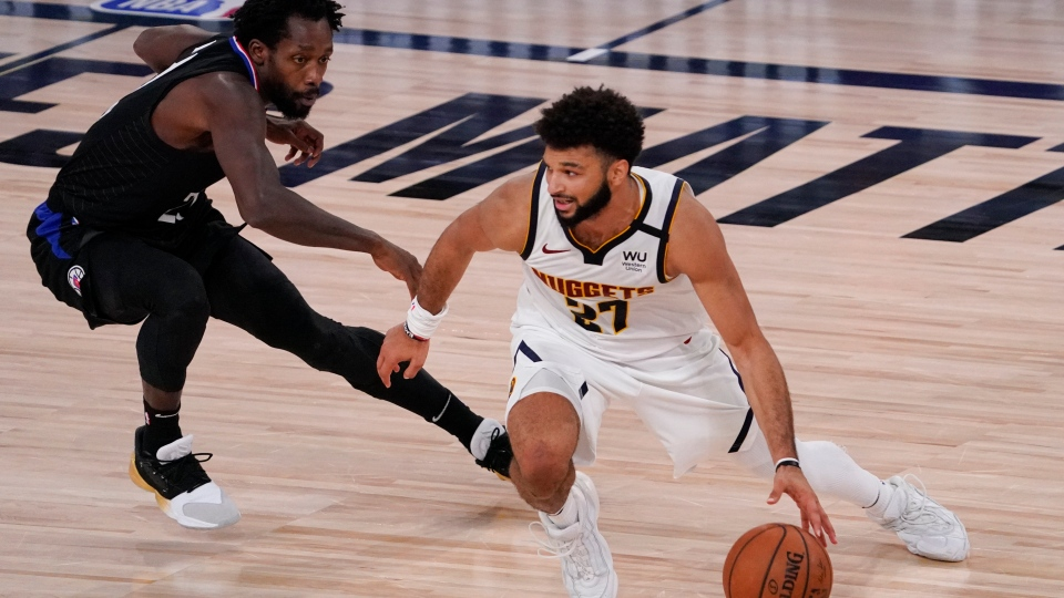 Denver Nuggets' Jamal Murray (27) drives past Los Angeles Clippers' Patrick Beverley, left, during the second half of an NBA conference semifinal playoff basketball game Saturday, Sept. 5, 2020, in Lake Buena Vista, Fla. The Nuggets won 110-101. (AP Photo/Mark J. Terrill)