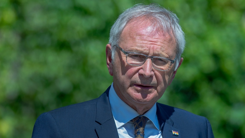 New Brunswick Premier Blaine Higgs talks with journalists after calling an election following a visit with Lt.-Gov Brenda Murphy at Government House in Fredericton on Monday, Aug. 17, 2020. The election will be held September 14. THE CANADIAN PRESS/Andrew Vaughan