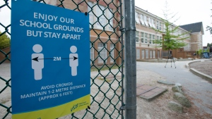 A physical distancing sign is seen during a media tour of Hastings Elementary school in Vancouver, Wednesday, September 2, 2020. THE CANADIAN PRESS/Jonathan Hayward