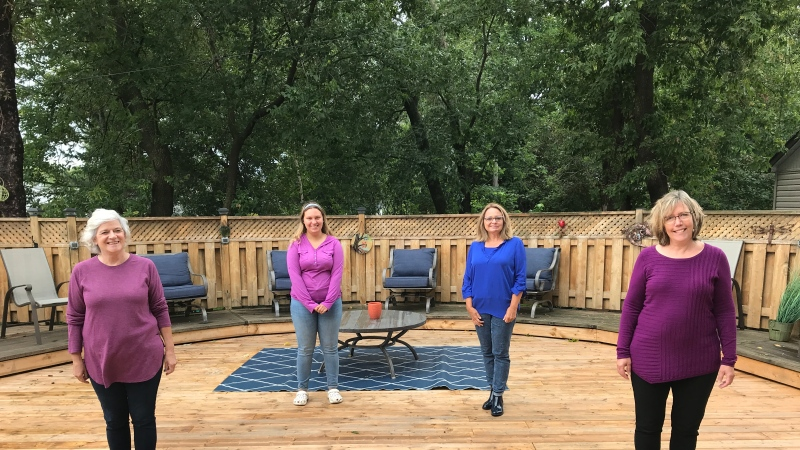 The members of the North Bay Rock Choir split into two groups in order to keep numbers down and practice outside on Boissonneault's deck which has become their mini stage for the time being. Sept. 7/20 (Alana Pickrell/CTV News Northern Ontario)