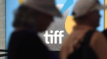 Signage appears as guests attend day one of the Toronto International Film Festival on Thursday, Sept. 5, 2019, in Toronto. With COVID-19 rattling the entire circuit, resulting in a trimmed Toronto International Film Festival slate that's mostly online, the industry is looking for new ways to gain momentum for projects that in many cases have been finished remotely during the pandemic. THE CANADIAN PRESS/AP, Chris Pizzello, Invision