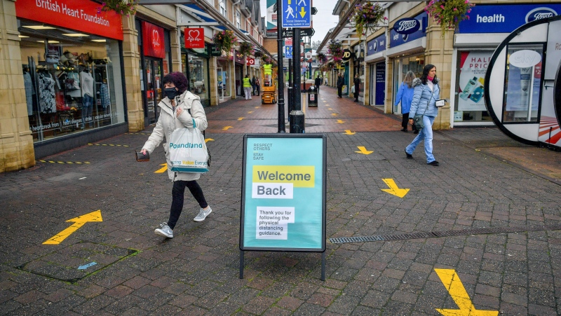 "One way systems are in place around shops in Caerphilly centre as the county borough is to be placed under a local lockdown following a ""significant rise"" in coronavirus cases, in Caerphilly, South Wales, Tuesday, Sept. 8, 2020. (Ben Birchall/PA via AP)"