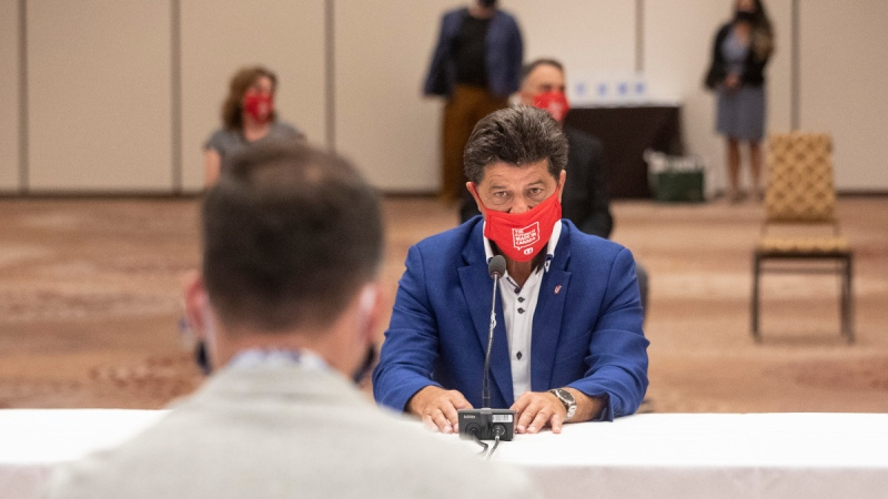 Jerry Dias, President of the Unifor union, sits opposite Ryan Kantautas, Vice President of Human Resources at Ford Canada, at the start of formal contract talks with the Detroit Three automakers, Fiat Chrysler, Ford and General Motors, in Toronto, on Aug. 12, 2020. (Chris Young / THE CANADIAN PRESS)