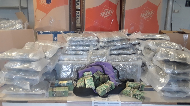 Cannabis and cash seized by police on Friday, Sept. 4, 2020 is seen in this image released by Middlesex OPP.