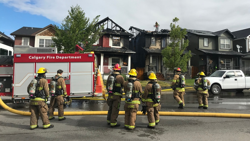CFD members in the 400 block of Evanston Dr. N.W. after extinguishing a house fire on Sep. 8, 2020