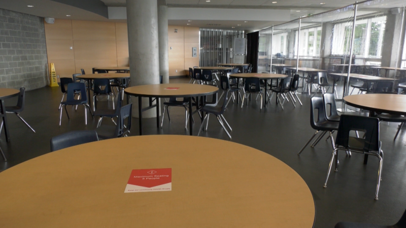 Empty tables are seen inside Mulgrave School in West Vancouver, B.C. before the start of the 2020 fall semester.