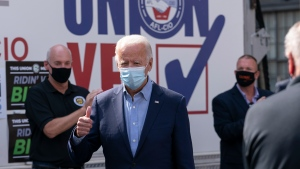 Democratic presidential candidate former Vice President Joe Biden gives the thumbs up as he arrives to pose for photographs with union leaders outside the AFL-CIO headquarters in Harrisburg, Pa., Monday, Sept. 7, 2020. (AP Photo/Carolyn Kaster)