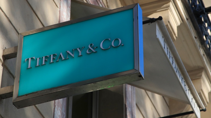 FILE - In this Nov.25, 2019 file photo, the logo of Tiffany jeweler shop is pictured on the Champs Elysees avenue in Paris. LVMH is ending its monthslong pursuit of luxury jewelry retailer Tiffany & Co., citing in part the impact of proposed tariffs on French goods. The Paris-based conglomerate said that it needs more time to assess the impact of U.S. tariffs on French goods and cannot close the deal before year-end. (AP Photo/Michel Euler, File)