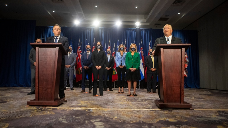 Ontario Premier Doug Ford, right, stands alongside Quebec Premier Francois Legault, left, as they hold a joint press conference during the Ontario-Quebec Summit, in Toronto on Wednesday, September 9, 2020. THE CANADIAN PRESS/Chris Young
